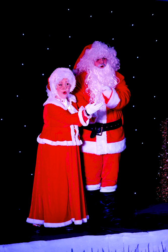 Mr and Mrs Santa on stage as part of the Nine Lives Christmas Variety Show.