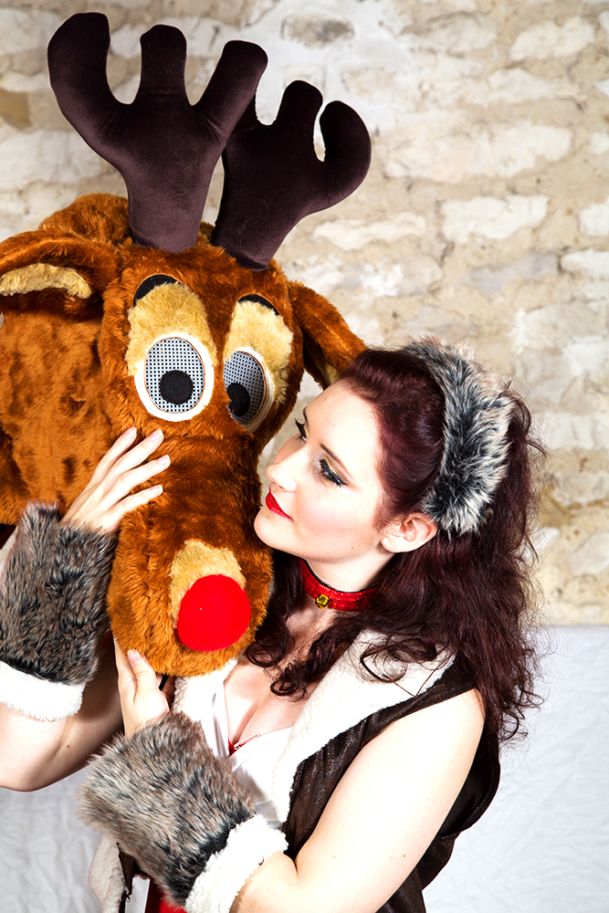 Rosie Christmas cuddles up to her best friend Rudolph as part of the Nine Lives Christmas Show.