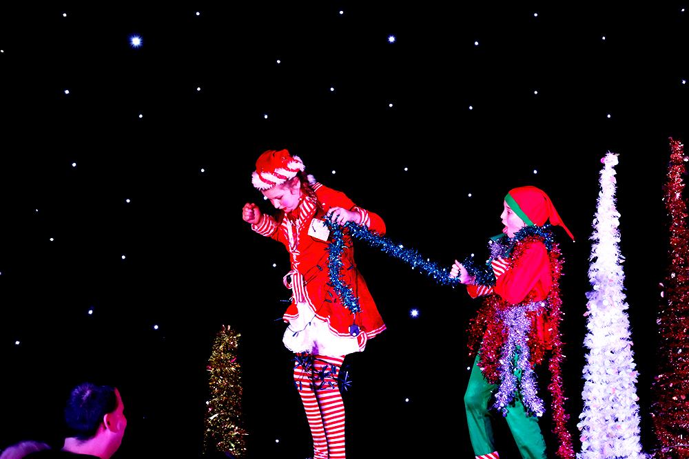 Two elves misbehave as part of The Nine Lives Christmas Variety Show.