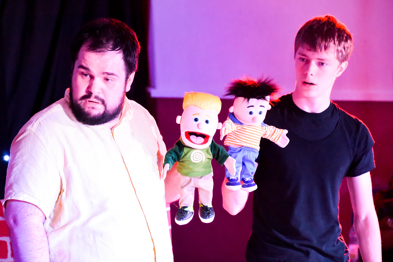 Nine Lives Theatre Company Students in performance with puppetry.