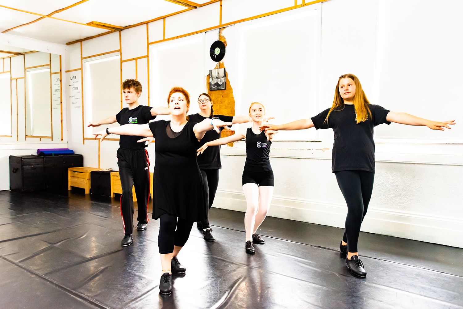 Nine Lives Theatre Company contemporary dancers in the practising their tap.